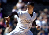 (DENVER, Co., SHOT 9/23/2004) The Colorado Rockies' Jeff Francis (#26) winds up to pitch against...