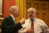 Colorado Secretary of State Mike Coffman (left) talks to Senator Ken Gordon during a hearing on...