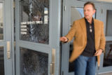 Church overseer Larry Stockstill leaves the bullet-riddled entryway of the New Life church in...