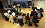 (Denver, Co. - SHOT 9/23/2004)   Catherine Sailer conducts a choral rehearsal Thursday  at DU's...