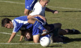 (DENVER, COLO., SEPTEMBER 23, 2004) - Mullen against Grandview's goalie, Sean Molony,...