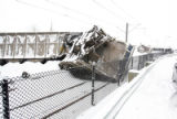 The southbound Santa Fe line of light rail is dereailed after some coal cars derail in front of it...