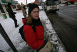 Margaret Stearns, 47, all layered for the cold gets ready to get on a bus to her next destination,...