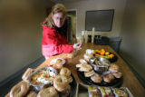 Margaret Stearns, 47, looks over a table of food given to clients at the Mental Health Center of...