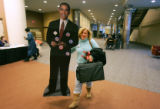 Sandee Tuman (cq), of politicalshop.com, holds a cut-out of Barck Obama as she sells buttons at a...