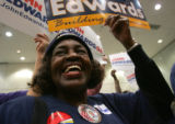 Susie Camper (cq), a members of steelworkers local 1123 in Canton, Ohio, cheers at a campaign stop...