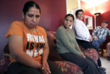 Balvina Murrufo, 38 left, and Rosalba Marrufo, 35 sit in their living room with their parents Luz,...