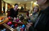 Wendy Bodwell shows her husband Winston Bodwell (cq) one of the bulbs in the bin with Rachel...