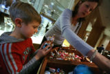 Evan Assenmacher, 6 of Boulder looks through the selection childrens decorations with his mother...