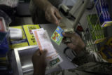 (NYT42) HOUSTON  -- Dec. 26, 2007 -- LOTTERY-SCRATCH-GAMES -- A customer buys a traditional...