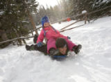 (Rocky Mountain National Park, Colo., Dec. 9, 2007) Emily Soule (7) uses her father, Brandon, as a...