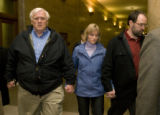 Alex Midyette's father J. Nold Midyette, his sister Kristin and her husband Craig Dennis(l-r) hold...