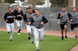 (2008) Pitcher Jason Marquis runs with his fellow pitchers t Colorado Rockies spring training at...