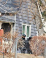 SWAT team members search the home of Tyler James Martin (cq) in the 1300 block of Oceola Street...
