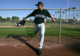(0128) Pitcher Huston Street stretches at Colorado Rockies spring training at Hi Corbett Field in...