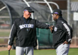(0188) Manager Clint Hurdle, left, talks with batting coach Don Baylor, right, at Colorado Rockies...