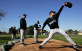 (0385) Coach Jim Wright watches Pitcher Jason Hirsh throws during Colorado Rockies spring training...