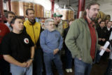 Brewers from more than a dozen Colorado micro- breweries gather at a press conference at the Great...