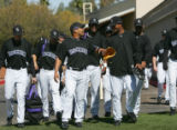 (0020) Yorvit Torrealba jokes around with Manuel Corpas at Colorado Rockies spring training at Hi...
