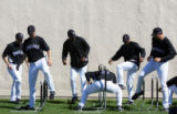 (0067) Members of the Rockies do a warm-up drill at Colorado Rockies spring training at Hi Corbett...