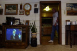 (10/08/2004) Idaho Springs-Robert Janes enters his living room while he and his wife Janice watch...
