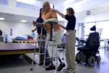 Donald Roberts tries walking on his new prosthetic legs at Spalding Rehab Hospital in Aurora on...