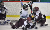Summit High School forward Max O'Neill (center), had his shot on Cheyenne Mountain High School...