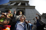 SR(060)  Seven-year-old Kevin Pacheco of Aurora looks up while his father Eugene Pacheco, 42,...