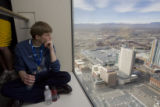 DM0966  Beau Croissant, 16, of Brighton enjoys the view from the 53rd floor of the Republic Plaza,...