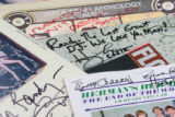 Autographs from Paul Simon, Jan & Dean, Herman's Hermit, and Eddie of the Turtles. ...