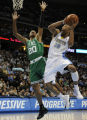 Dahntay Jones sinks a basket against #20 Ray Allen in the 1st half as the Nuggets host the Boston...