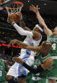 Carmelo Anthony has a shot blocked as he is swarmed by the Celtics defense  in the 1st period  as...