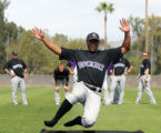 (0192) Chris nelson slides during a drill at Colorado Rockies spring training at Hi Corbett Field...
