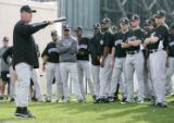 (0857) Coach Rick Matthews talks with the players at Colorado Rockies spring training at Hi...