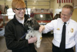 Kevin Ruby, 16, (cq) holds his dog Shizzle (cq), a shitzo, inside the South Metro Fire Rescue...