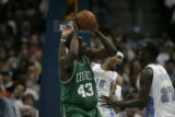 Carmelo Anthony and Johan Petro (cq) of the Nuggets defend Kendrick Perkins (cq) of the Celtics...