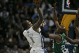 J.R. Smith (cq) of the Nuggets is defended against Ray Allen (cq) of the Celtics at the Pepsi...