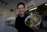 Tom Bird, owner of Pho Fusion holds up some of his fresh bowls at Denver, Colo.Tuesday, February...