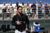 (1149) Randy Flores places his cap over his heart during th National Anthem before the Colorado...
