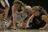 #34 Danielle Stephan (cq) of Green Mountain and #32 Sierra Bender (cq) of Fairview watch the ball...
