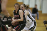 #10 Erika Eppard (cq) of Green Mountain tries to steal the ball from  #21 Casey Thayer (cq) as  of...