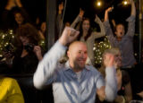 DM0217  57069 The West End Tavern erupts in celebration after Hosea Rosenberg, center, the chef at...