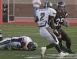 (AURORA, Colo., September24, 2004) Ben Miller, Grandview's #35, carries the ball upfield into...