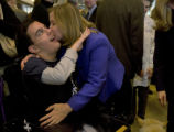 Kelly Stahlman gives her son Eric Stahlman, 16 a kiss at the Denver Health Medical Center,...