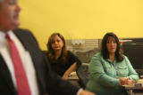 Employees of the Rocky Mountain News, including office manager Lizzy McCormick, right, and...