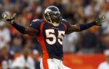 (Denver., on Sun. Oct. 10, 2004)   Denver Broncos linebacker Patrick Chukwurah, #55, celebrates...