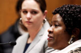 Sister of Trevor Jones, Jennifer, listens to Linda Mitchell, aunt of Dietrick Mitchell, speak...