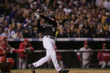 The Colorado Rockies' Brad Hawpe delivers a single in the second inning. The Philadelphia Phillies...