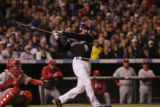 The Colorado Rockies' Brad Hawpe has a basehit in the eighth inning to move Garrett Atkins to...