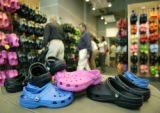 Customers shop for Crocs brand sandals at the Pedestrian Shop in Boulder, Colorado. The American...